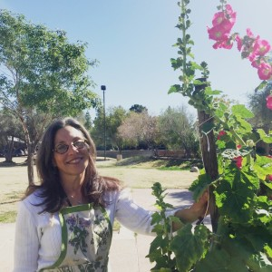 JoAnn Sanchez in SCNM herb garden